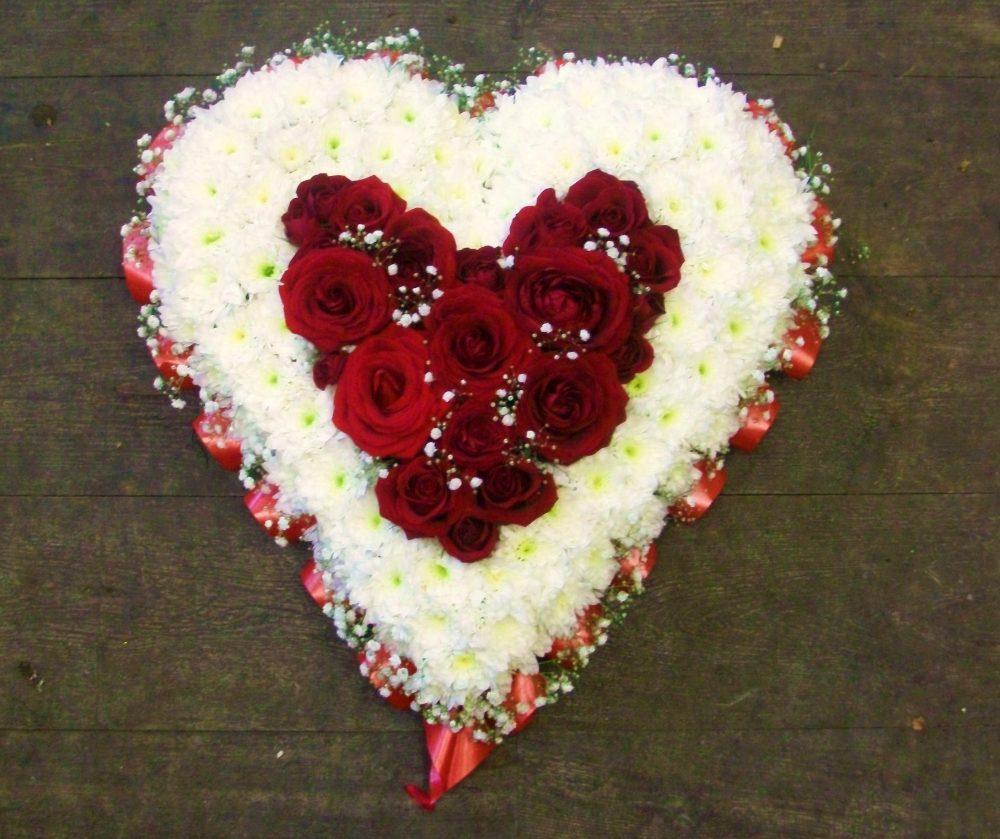 Heart within floral arrangement
