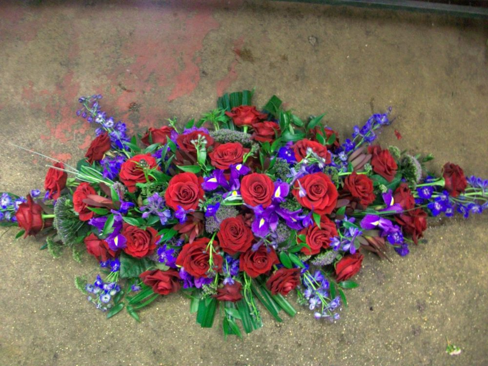 Red and blue spray floral arrangement